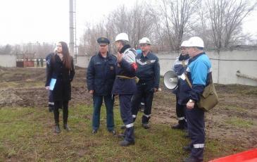 Командир АСО Гиматов Т. Ф. докладывает представителю ГУ МЧС РФ